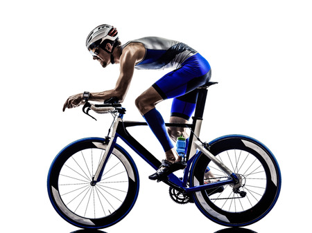 racing bike: man triathlon iron man athlete bikers cyclists bicycling biking  in silhouettes on white background Stock Photo