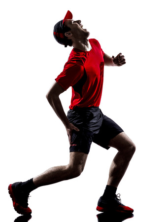 cramps: one young man runners joggers running injury pain cramps in silhouettes isolated on white