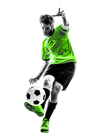 one soccer football player young man kicking in silhouette studio on white background