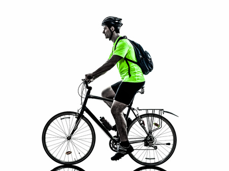 profile views: one  man exercising bicycle mountain bike on white background