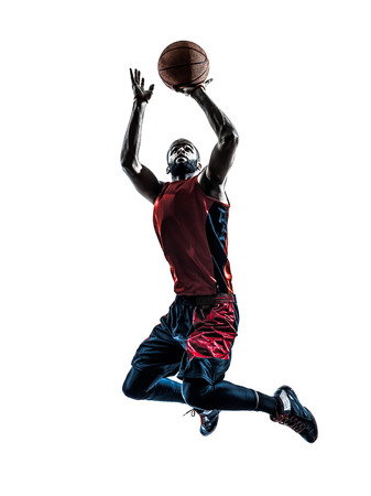 basketball player: one african man basketball player jumping throwing in silhouette isolated white background