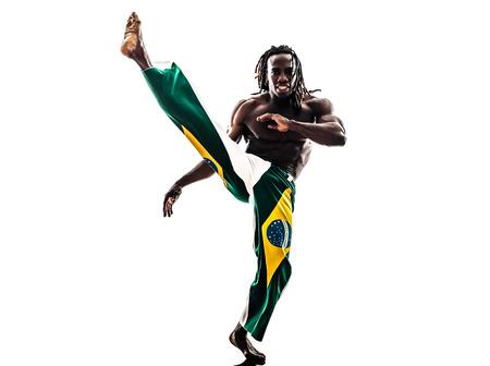 one Brazilian black man dancer dancing capoeira on white background photo