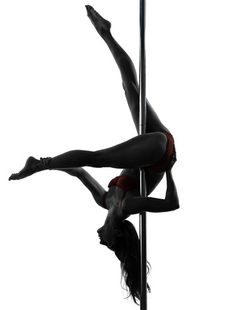 pole dance: one  woman pole dancer dancing in silhouette studio isolated on white background