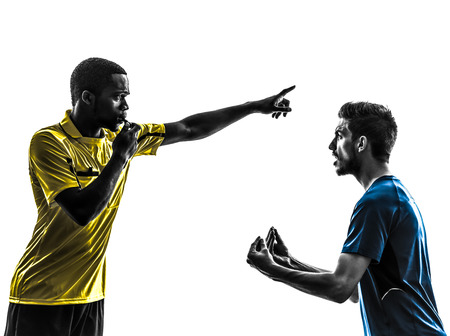 two men soccer player and referee in silhouette on white background photo