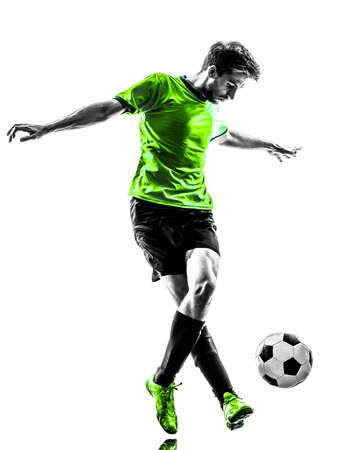 one young man: one soccer football player young man dribbling in silhouette studio on white background Stock Photo