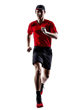 men running: one young man runners joggers running jogging jumping in silhouettes isolated on white background Stock Photo