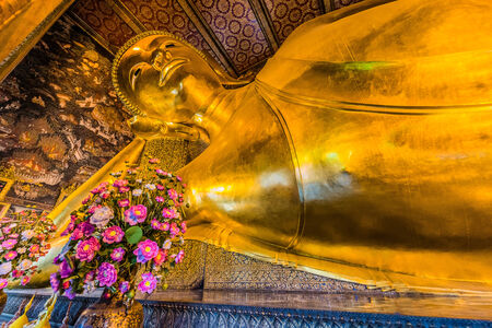 reclining buddha portrait at Wat Pho temple Bangkok Thailand photo