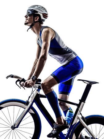 man triathlon iron man athlete bikers cyclists bicycling biking  in silhouettes on white background photo