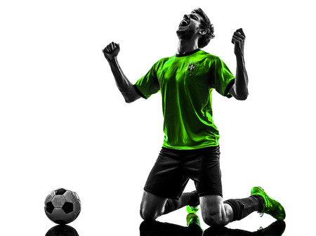 one soccer football player young man happiness joy kneeling in silhouette studio on white background photo