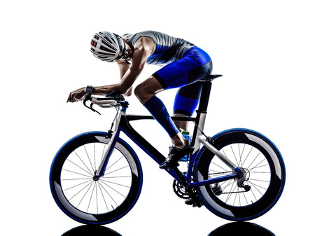triathlon: man triathlon iron man athlete biker cyclist bicycling biking  in silhouette on white background Stock Photo