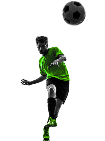one soccer football player young man in silhouette studio on white background photo