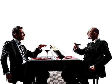 dva podnikatelé jídelna v siluety na bílém pozadí