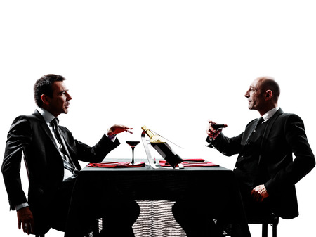 two businessmen dinning in silhouettes on white background