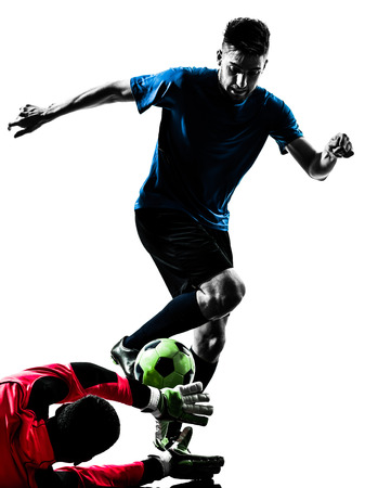 two  soccer player goalkeeper men competition in silhouette isolated white background Stock Photo