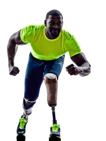 one muscular handicapped man starting line   with legs prosthesis in silhouette on white background photo