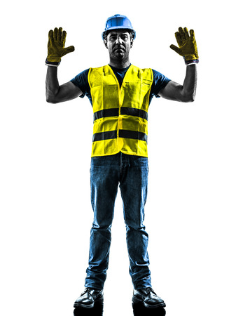 signaling: one construction worker signaling stop gesture with safety vest silhouette isolated in white background Stock Photo