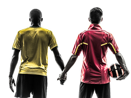 fairplay: two men soccer player playing football competition hand in hand in silhouette on white background