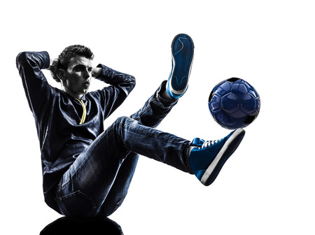 one  young man soccer freestyler player in silhouette on white background photo