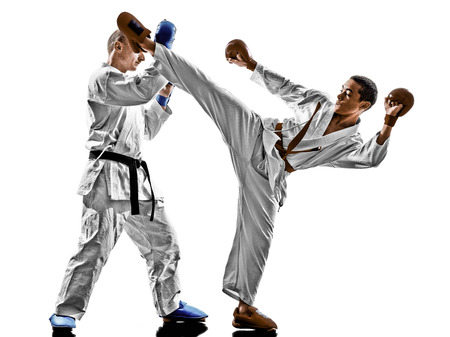 sensei: two karate men sensei and teenager student fighters fighting protections isolated on white
