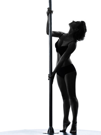 one  woman pole dancer dancing in silhouette studio isolated on white  photo
