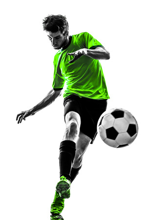 one soccer football player young man kicking in silhouette studio on white  photo