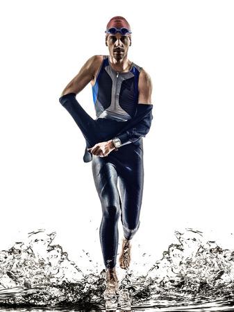 triathlon: man triathlon iron man athlete swimmers swimmers running in silhouette on white  Stock Photo