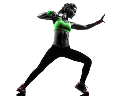 one woman: one  woman exercising fitness zumba dancing in silhouette on white  Stock Photo