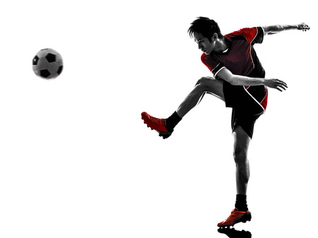 one asian soccer player young man kicking in silhouette isolated white background photo