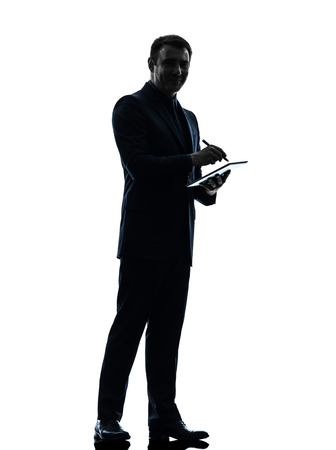 stylus: one  business man holding digital pen stylus tablet in silhouette on white background