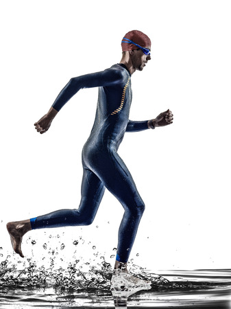 man triathlon iron man athlete swimmers swimmers running in silhouette on white background photo