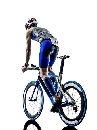 man triathlon iron man athlete biker cyclist bicycling biking in silhouette on white background Imagens - 29166611