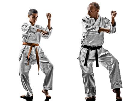 sensei: two karate men sensei and teenager student teacher teaching isolated on white background