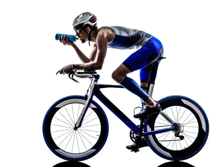 'cycles: man triathlon iron man athlete biker cyclist bicycling biking drinking in silhouette on white background