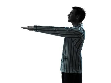 sleepwalking: one man in pajamas sleepwalker sleepwalking silhouettes on white background