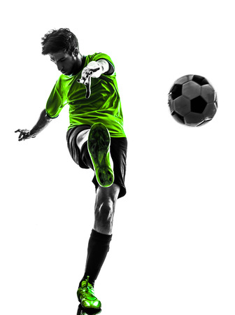 young man kicking in silhouette  photo