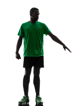 one african man soccer player green jersey in silhouette on white background photo