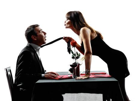 sexuel: Couples amoureux dinning en silhouette Banque d'images