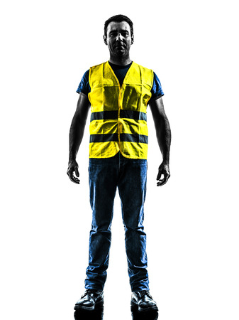 safety vest: one man standing in yellow safety vest silhouette isolated in white