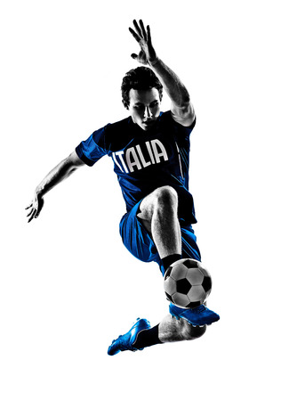 one italian soccer player man playing football jumping in silhouette white  photo