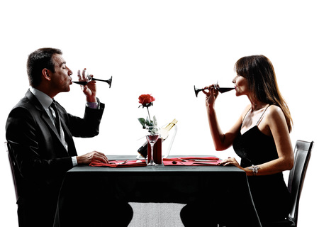 couples lovers dinning drinking wine in silhouettes on white background Stock Photo