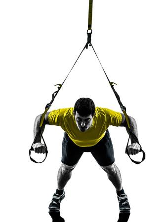 one  man exercising suspension training trx on white background