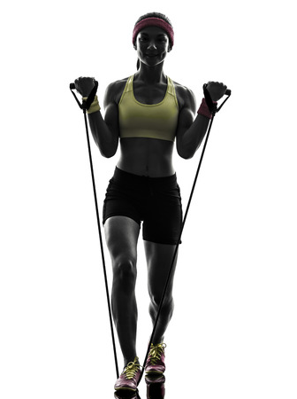 rubber bands: one woman exercising fitness workout resistance bands in silhouette on white background