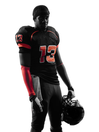 american football player: one american football player standing in silhouette shadow on white background Stock Photo