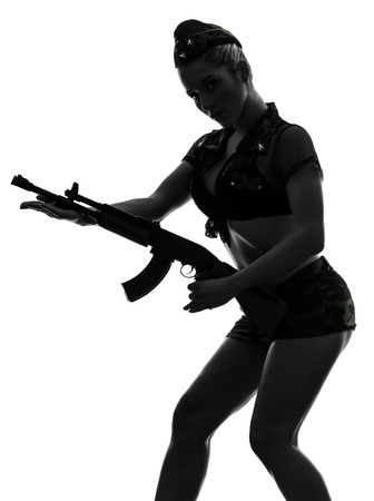 one  sexy woman in army uniform holding kalachnikov in silhouette studio isolated on white background photo