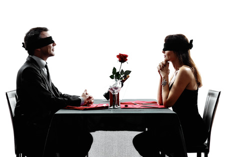 Blind Date: couples lovers dinning blind date in silhouettes on white background