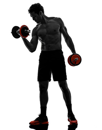 one man topless muscular exercising body building weights training in silhouettes on white background photo