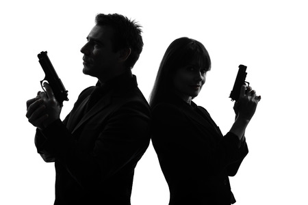 shooters: couple woman man detective secret agent criminal with gun in silhouette studio isolated on white background