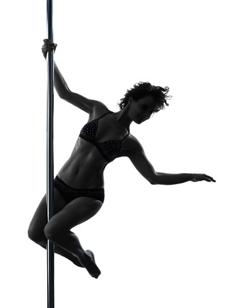 one  woman pole dancer dancing in silhouette studio isolated on white background photo