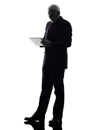 One Caucasian Senior Business Man holding digital tablet Silhouette White Background photo