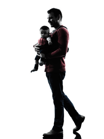 one man father walking with baby in silhouettes on white background Stock Photo - 29568744
